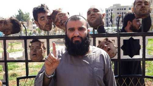 Jihadi with heads on a fence